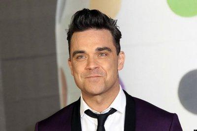 Robbie Williams y Black Eyed Peas participarán en show benéfico de Mánchester