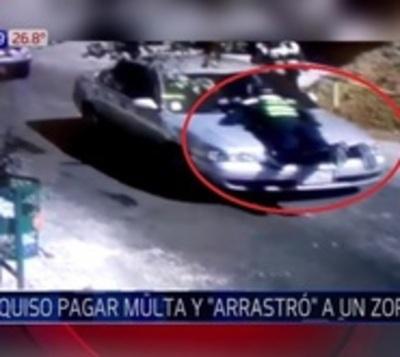 Conductor arrastró a policía de tránsito para evitar pagar multa