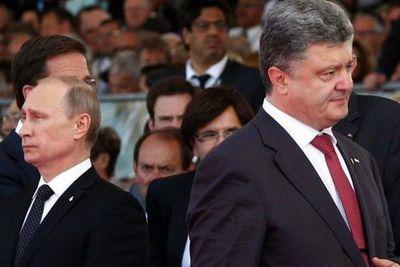 Poroshenko promulga ley marcial y Putin refuerza Crimea con misiles