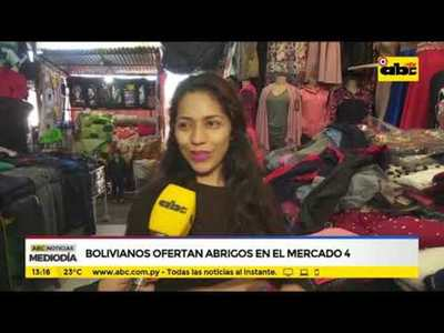 Bolivianos ofertan abrigos en el mercado 4