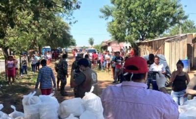HOY / Primera Dama y militares distribuyen almuerzo a varios barrios capitalinos